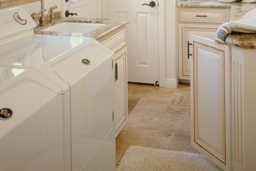 Bathroom Cabinets with White Paint with Glaze Raised Panel Doors Rope Molding Rope Detail on Doors