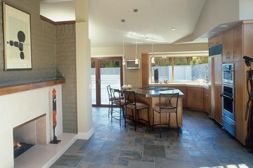 Alder Kitchen Cabinets Bookmatched Aires Doors Angled Island Seating Corner Sink Wood Panels on Refrigerator
