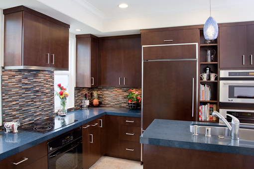 Kitchen Cabinets with Bookmatched Aires Doors Wood Panels on Refrigerator Sink in the Island Flat Crown Molding