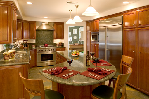 Kitchen Cabinets in Cherry with Raised Panels and Full Overlay