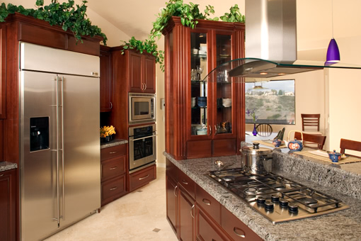 Kitchen Cabinets with Cherry Finish Raised Panels and Fluted Styles
