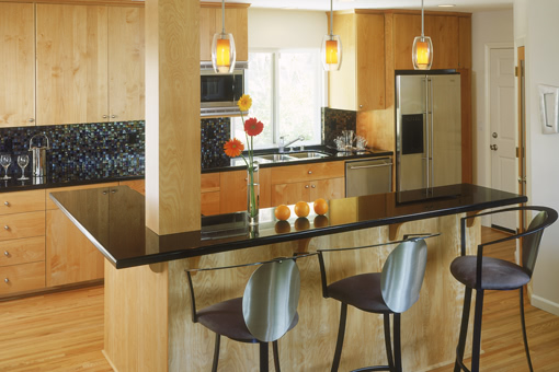 Contemporary Kitchen Cabinets with Red Birch and Bookmatched Doors