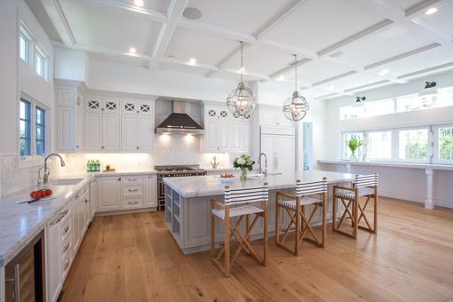 Beach House Kitchen Cabinets Painted White with Malibu Doors Flush Inset, Latch Locks, X French Lites and Paneled Refrigerator / Dishwasher